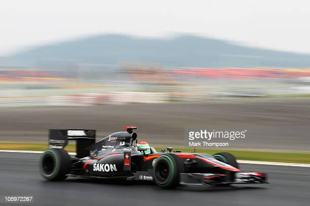 Sakon Yamamoto of Japan and Hispania Racing Team drives during qualifying for the Korean Formula One Grand Prix at the Korea International Circuit on...