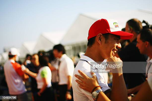 Sakon Yamamoto of Japan and Hispania Racing Team is interviewed in the paddock during previews to the Japanese Formula One Grand Prix at Suzuka...