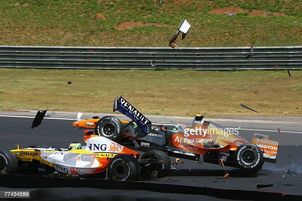 Sakon Yamamoto of Japan and Spyker F1 runs into the back of Giancarlo Fisichella of Italy and Renault at the start of the Brazilian Formula One Grand...