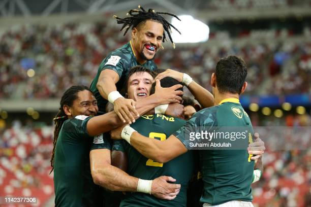 Sakoyisa Makata of South Africa is congratulated by his team mates after scoring a try during the Pool A match between South Africa and Canada on day...