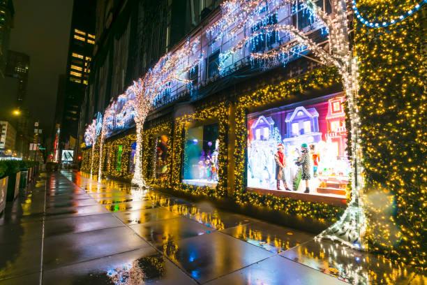 Saks Fifth Avenue Christmas window displays glow in the rainy dawn on Christmas 2020.