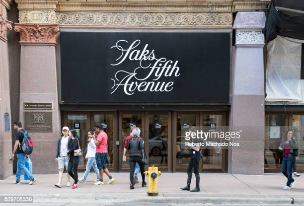 Saks Fifth Avenue sign logo in downtown district and everyday lifestyle The retailer is an American luxury department store owned by the oldest...