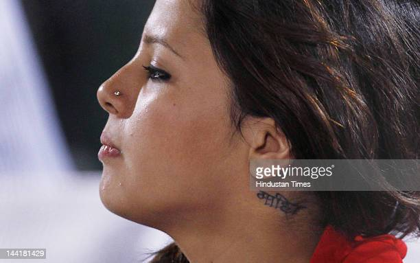 Sakshi Dhoni wife of Indian captain M S Dhoni is seen with Dhoni's nickname Mahi tatooted on her nec during IPL 5 T20 match played between Rajasthan...