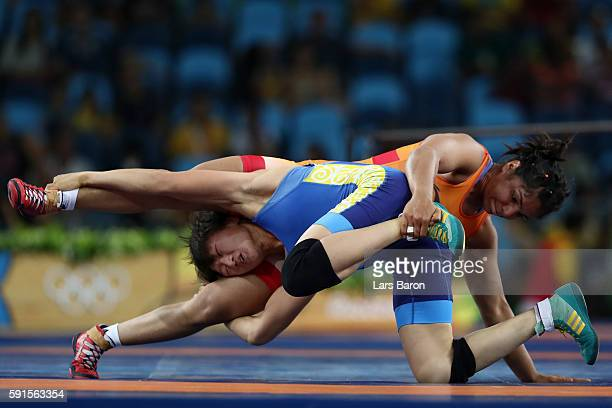 Sakshi Malik of India competes against Aisuluu Tynybekova of Kyrgyzstan during the Women's Freestyle 58 kg Bronze match on Day 12 of the Rio 2016...