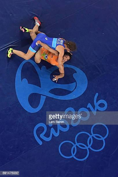 Sakshi Malik of India competes against Valeriia Koblova Zholobova of Russia during a Women's Freestyle 58kg Quarterfinal bout on Day 12 of the Rio...