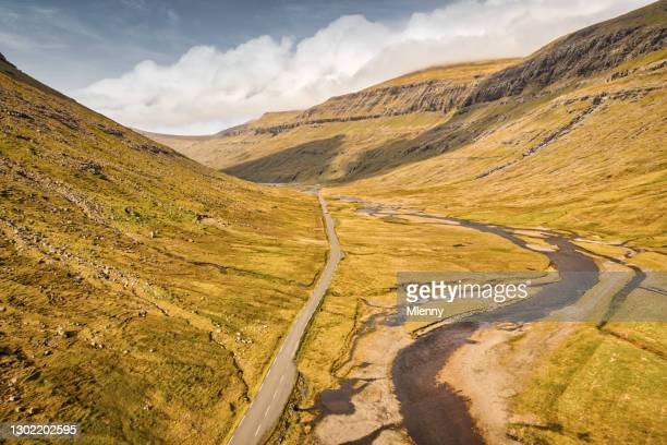 saksun valley country road faroe islands streymoy island drone view - mlenny stock pictures, royalty-free photos & images