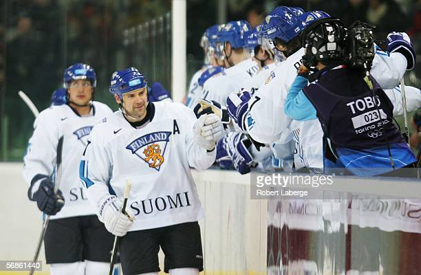Saku Koivu of Finland celebrates with his team mates after scoring the first goal during the men's ice hockey Preliminary Round Group A match between...