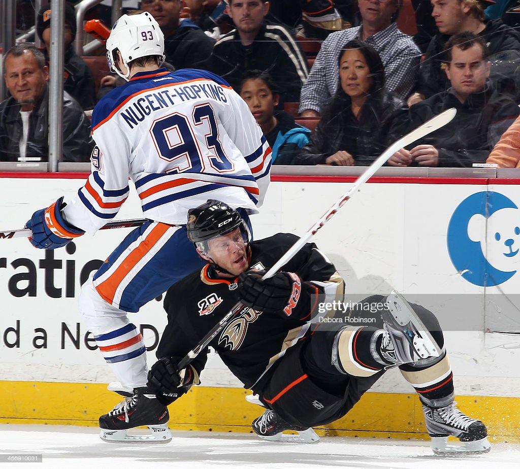 Saku Koivu #11 of the Anaheim Ducks battles for position against Ryan Nugent-Hopkins #93 of the Edmonton Oilers on December 15, 2013 at Honda Center in Anaheim, California.