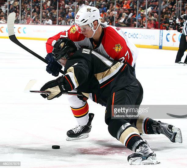 Saku Koivu of the Anaheim Ducks battles for the puck against Nick Bjugstad of the Florida Panthers on March 23 2014 at Honda Center in Anaheim...