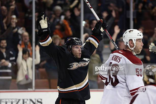 Saku Koivu of the Anaheim Ducks celebrates his game winning goal in overtime as Derek Morris of the Phoenix Coyotes looks on at Honda Center on...