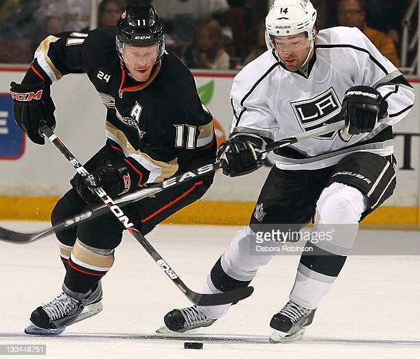 Saku Koivu of the Anaheim Ducks defends against Justin Williams of the Los Angeles Kings during the game on November 17 2011 at Honda Center in...
