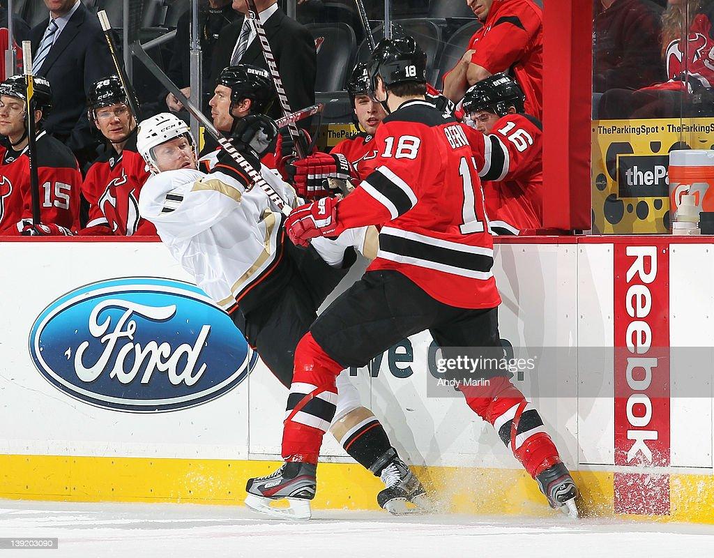 4cdf03656 Saku Koivu of the Anaheim Ducks is checked off balance by Steve ...