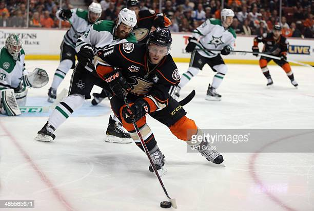 Saku Koivu of the Anaheim Ducks is pursued by Jordie Benn of the Dallas Stars for the puck in the third period of Game Two of the First Round of the...