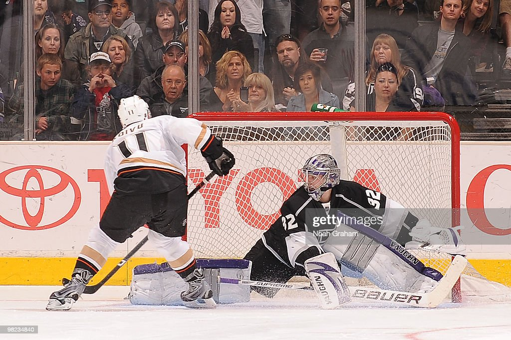 Saku Koivu #11 of the Anaheim Ducks scores the game winning goal in the shootout against Jonathan Quick #32 of the Los Angeles Kings on April 3, 2010 at Staples Center in Los Angeles, California.