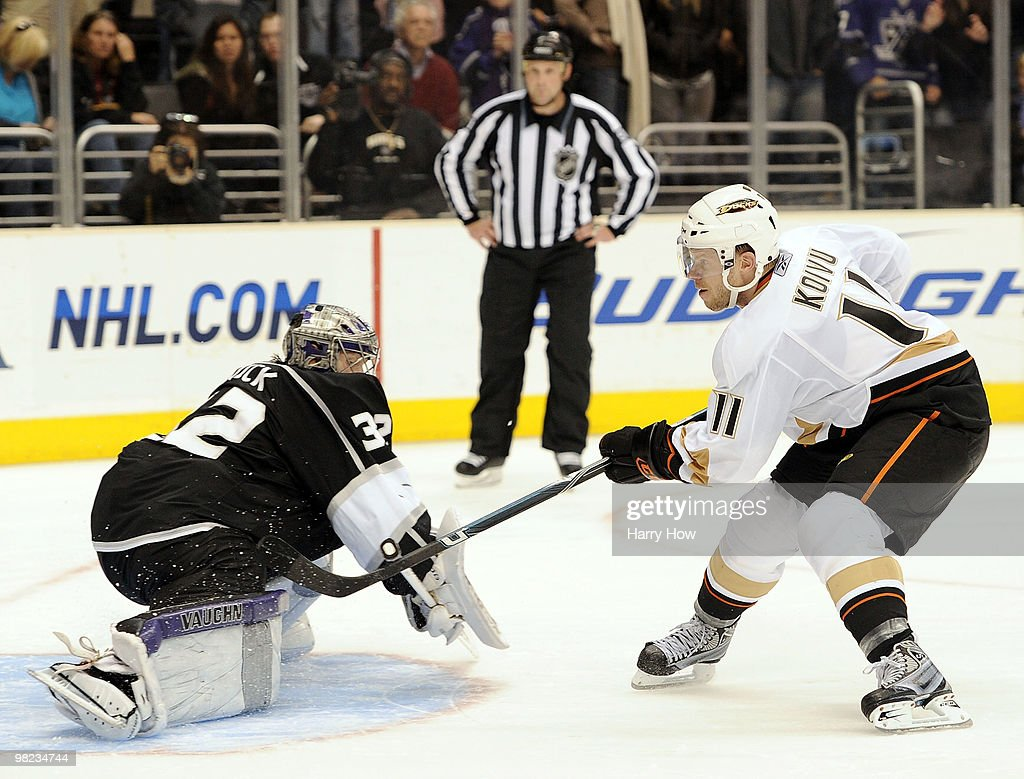 Saku Koivu #11 of the Anaheim Ducks scores the game winning goal past Jonathan Quick #32 of the Los Angeles Kings during the overtime shootout period at the Staples Center on April 3, 2010 in Los Angeles, California.
