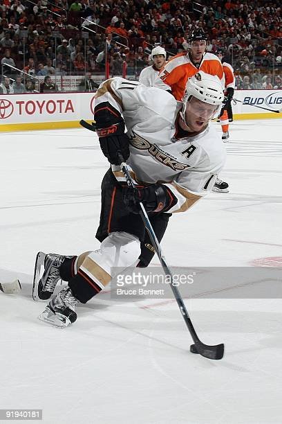 Saku Koivu of the Anaheim Ducks skates with the puck during the game against the Philadelphia Flyers at the Wachovia Center on October 10 2009 in...