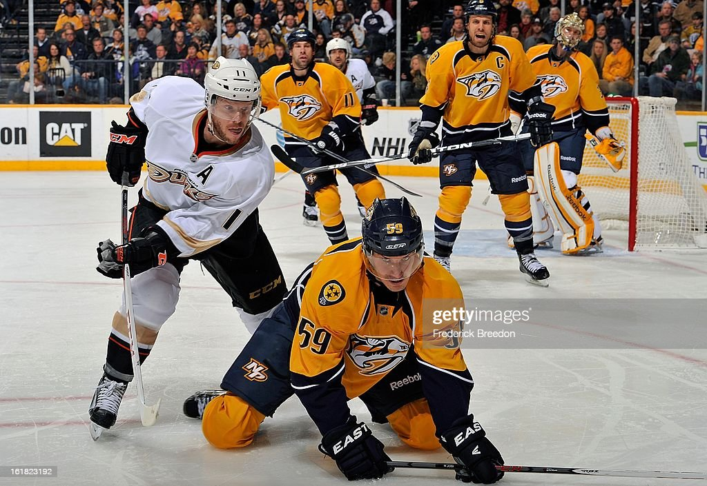 Saku Koivu #11 of the Anaheim Ducks stands over Roman Josi #59 of the Nashville Predators at the Bridgestone Arena on February 16, 2013 in Nashville, Tennessee.