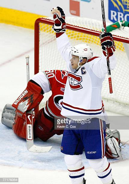 Saku Koivu of the Montreal Canadiens celebrates after scoring the gamewinning goal against the Carolina Hurricanes October 3 2007 at RBC Center in...