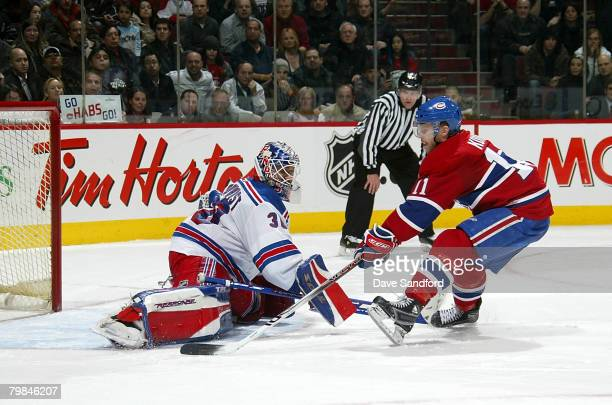Saku Koivu of the Montreal Canadiens scores the winning goal against Henrik Lundqvist of the New York Rangers in the shootout February 19 2008 at the...