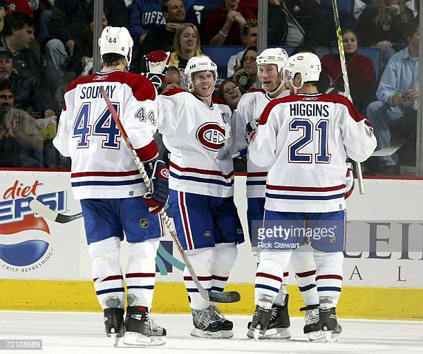 Saku Koivu of the Montreal Canandiens celebrates with teammates after scoring Montreal's third goal against the Buffalo Sabres on October 6, 2006 at...