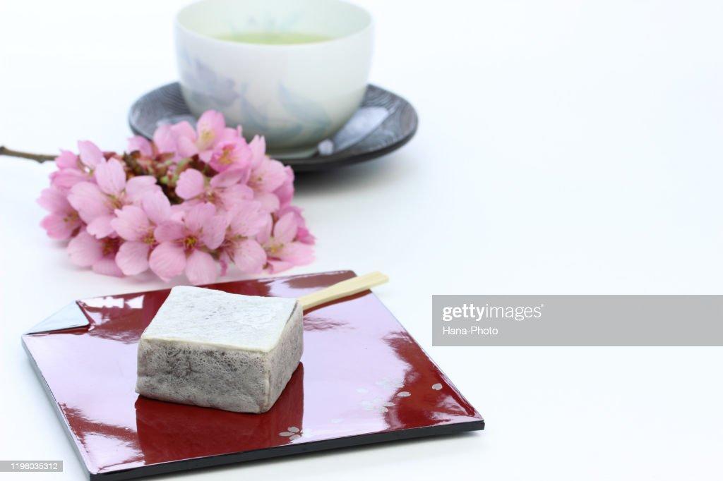 sakura and wagashi  (kintsuba) : Stock Photo