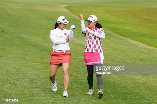 Sakura Koiwai and Minami Katsu of Japan share a laugh on the 17th hole during the first round of the HokennoMadoguchi Ladies at Fukuoka Country Club...