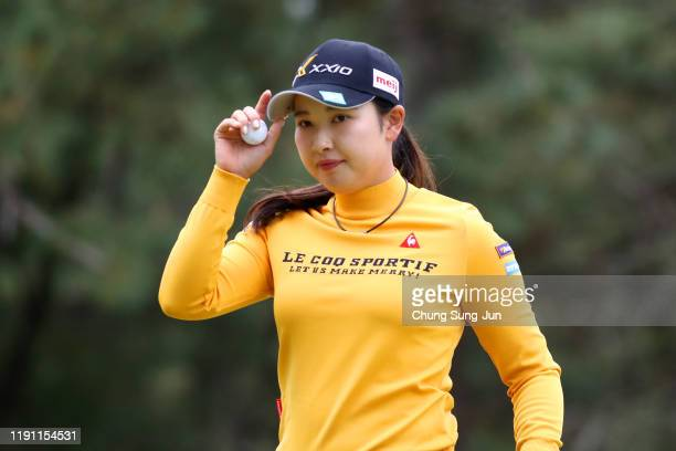 Sakura Koiwai of Japan acknowledges on the 5th green during the final round of the LPGA Tour Championship Ricoh Cup at Miyazaki Country Club on...