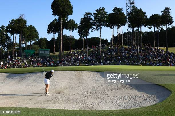 Sakura Koiwai of Japan hits out from a bunker on the 18th hole during the second round of the Hisako Higuchi Mitsubishi Electric Ladies at...