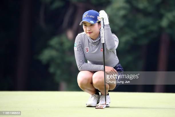 Sakura Koiwai of Japan lines up a putt on the 2nd green during the final round of the Hisako Higuchi Mitsubishi Electric Ladies at Musashigaoka Golf...