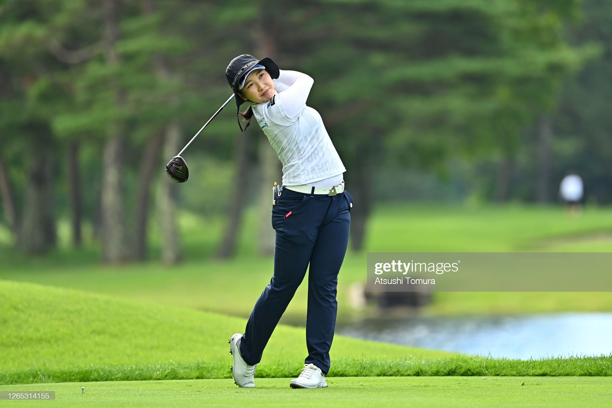 https://media.gettyimages.com/photos/sakura-koiwai-of-japan-plays-a-shot-on-the-4th-hole-during-a-practice-picture-id1265314155?s=2048x2048