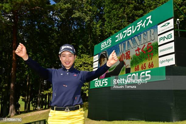 Sakura Koiwai of Japan poses for photographs after winning the tournament following the final round of the GOLF5 Ladies Tournament at the GOLF5...