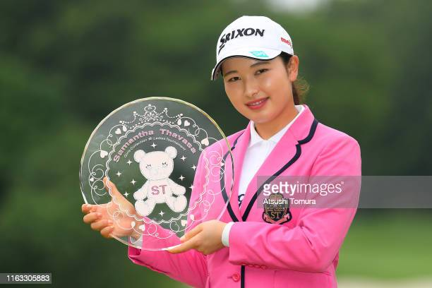 Sakura Koiwai of Japan poses with the trophy after winning the Thamansa Thavasa Girls Collection Ladies Tournament at the Eagle Point Golf Club on...