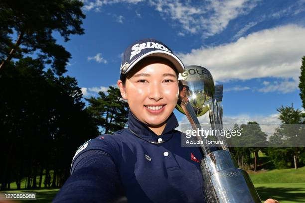 Sakura Koiwai of Japan poses with the trophy after winning the tournament following the final round of the GOLF5 Ladies Tournament at the GOLF5...