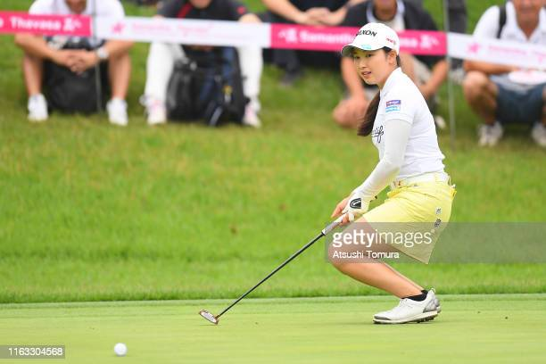 Sakura Koiwai of Japan putts on the 17th hole during the final round of the Thamansa Thavasa Girls Collection Ladies Tournament at the Eagle Point...