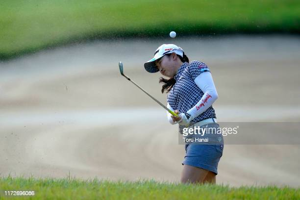 Sakura Koiwai of Japan reacts as her shot bouncing back after hitting the edge of bunker on the 18th hole during the first round of the Golf5 Ladies...
