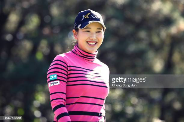 Sakura Koiwai of Japan smiles after her tee shot on the 4th hole during the second round of the LPGA Tour Championship Ricoh Cup at Miyazaki Country...
