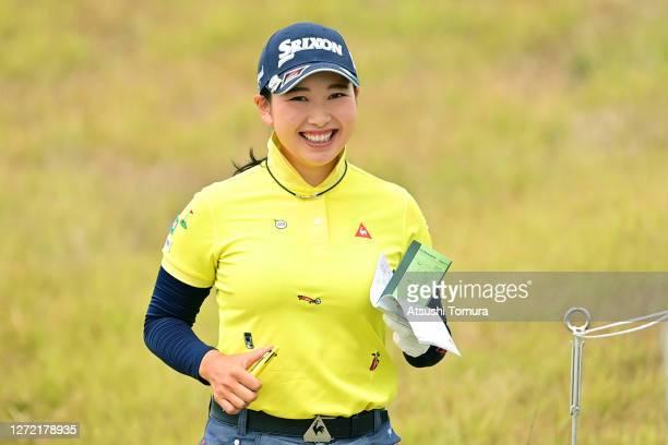 Sakura Koiwai of Japan smiles on her way to the 2nd tee during the final round of the JLPGA Championship Konica Minolta Cup at the JFE Setonaikai...