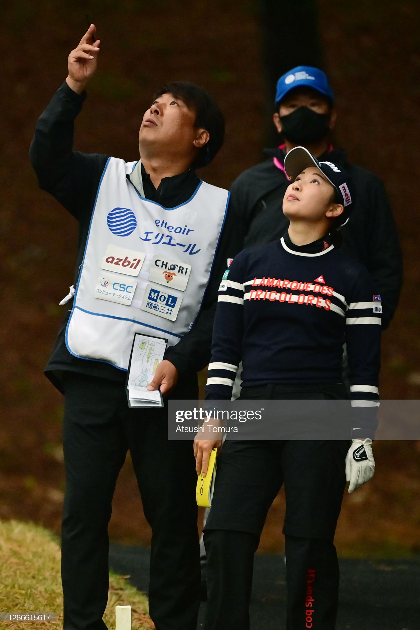 https://media.gettyimages.com/photos/sakura-koiwai-of-japan-talks-with-her-caddie-on-the-3rd-tee-during-picture-id1286615617?s=2048x2048
