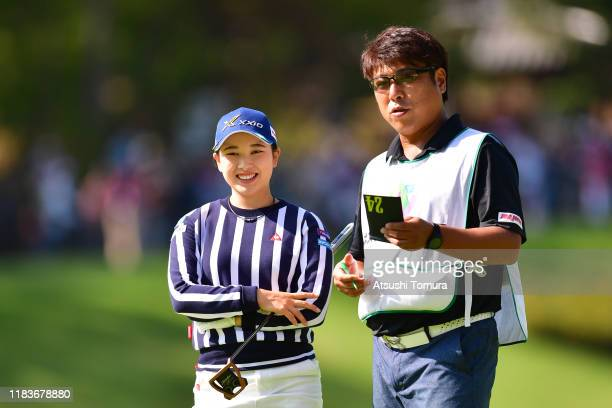 Sakura Koiwai of Japan talks with her caddie on the 7th green during the final round of the Nobuta Group Masters GC Ladies at Masters Golf Club on...