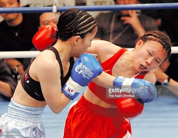 Sakura Ouchi and Yuri Kobayashi exchange punches during the GLegend first women's professional boxing match at Korakuen Hall on May 9 2008 in Tokyo...