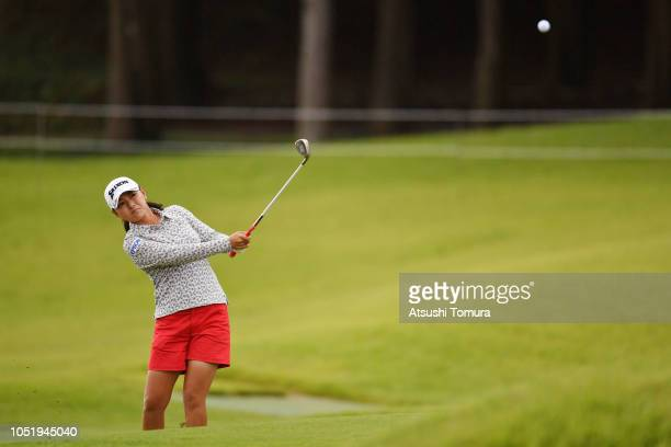 Sakura Yokomine of Japan hits from a bunker on the 10th hole during the first round of the Fujitsu Ladies at Tokyu Seven Hundred Club on October 12...