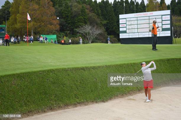 Sakura Yokomine of Japan hits from a bunker on the 18th hole during the first round of the Fujitsu Ladies at Tokyu Seven Hundred Club on October 12...