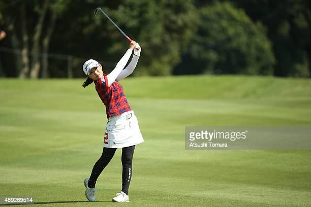 Sakura Yokomine of Japan hits her second shot on the 14th hole during the final round of the Munsingwear Ladies Tokai Classic at the Shin Minami...