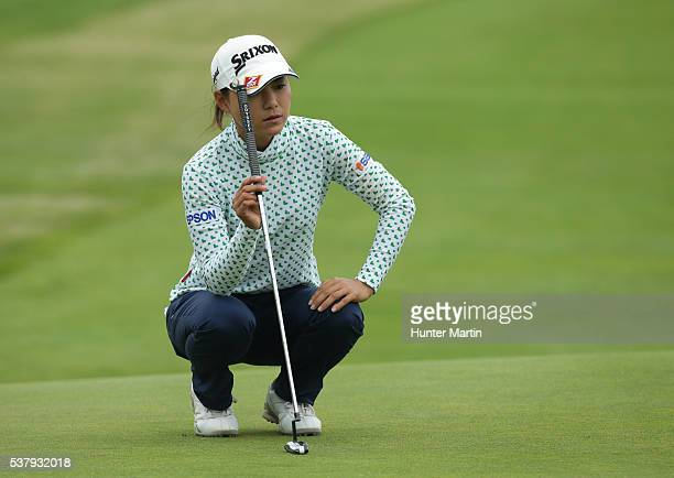 Sakura Yokomine of Japan lines up her putt on the 18th hole during the first round of the ShopRite LPGA Classic presented by Acer on the Bay Course...