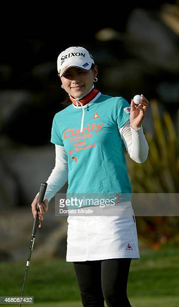 Sakura Yokomine of Japan shows her ball on the 18th hole during Final Round of the LPGA KIA Classic at the Aviara Golf Club on March 29 2015 in...