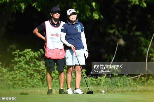 Sakura Yokomine of Japan speaks with her caddie on the eighth tee during the first round of the Meijer LPGA Classic for Simply Give at Blythefield...