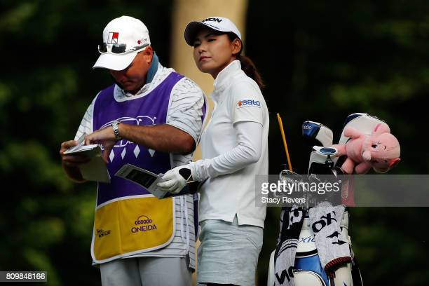 Sakura Yokomine of Japan speaks with her caddie on the second hole during the first round of the Thornberry Creek LPGA Classic at Thornberry Creek at...