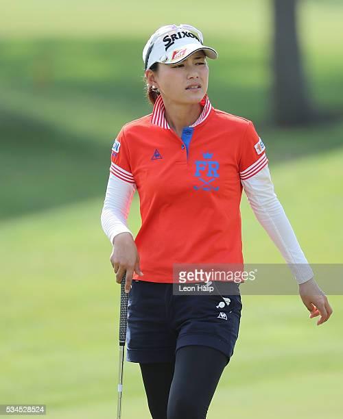 Sakura Yokomine of Japan walks to the eighteenth green during the first round of the LPGA Volvik Championship on May 26 2016 at Travis Pointe Country...