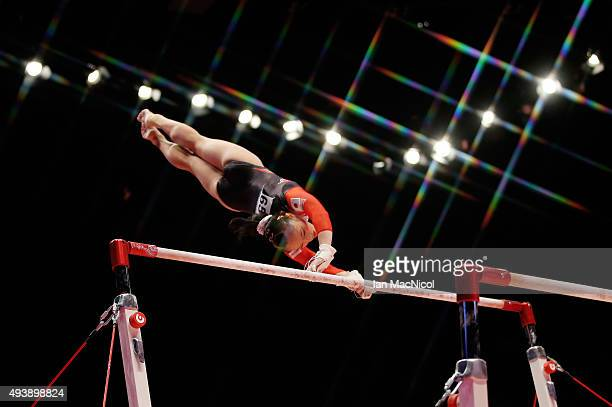 Sakura Yumoto of Japan goes through her routine on the Uneven Bars during Day One of the 2015 World Artistic Gymnastics Championships at The SSE...