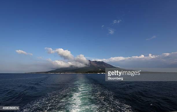 Sakurajima volcano is seen from a ferry traveling in Kinkowan Bay Kagoshima Japan on Sunday Oct 26 2014 Japans economy tumbled into its steepest...